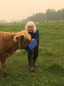 Shannon Laackmann and her Highland Cow